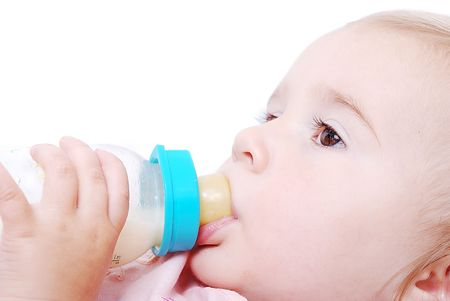 hand holding bottle: Cute baby is drinking a milk from the bottle Stock Photo