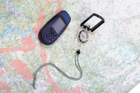 Man, map, compass, gps turned off, equipment all around Stock Photo - 5154975