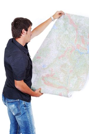Man standing and looking at maps in his hands Stock Photo - 5142584
