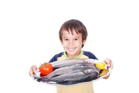 model fish: Smiling kid with fresh fish on table