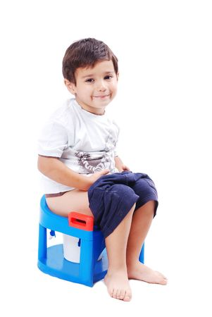 Kid is shiting on his toilet and smiling photo