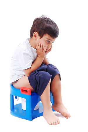 shit: Kid is shiting on his toilet and looking in front of him