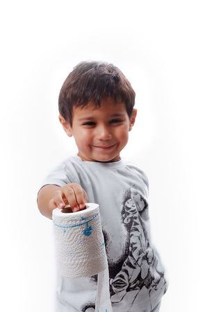 Cute kid is holding toilet paper and smiling photo