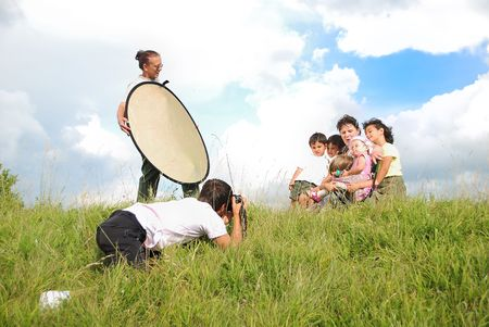 reflectors: Professional photographer is shooting in nature with assistent Stock Photo
