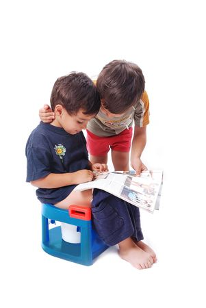 Two cute kids looking at body building pictures photo