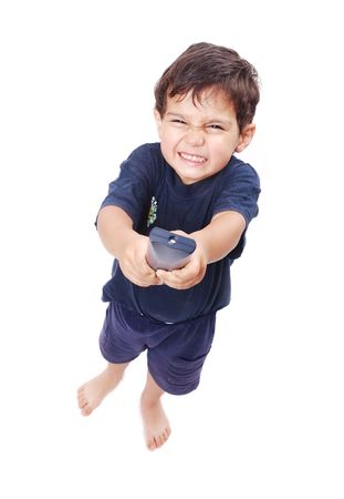 Kid is pressing remote control button to change adult Stock Photo - 5142156