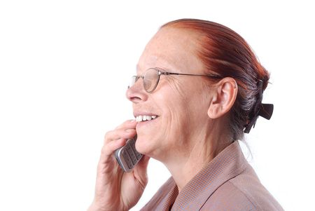 Middle aged woman is speaking on phone photo