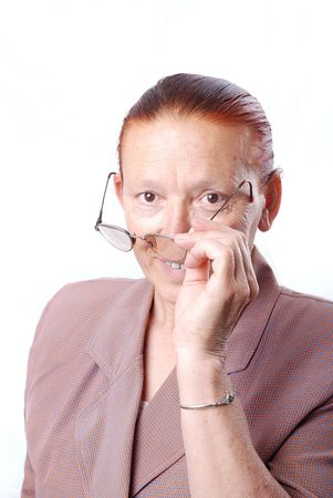 Middle aged woman is holding her glasses photo