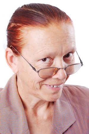 Middle aged woman is holding her glasses and smiling photo