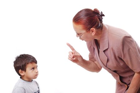 Strong grandmother is talking hard talk with her grandson photo