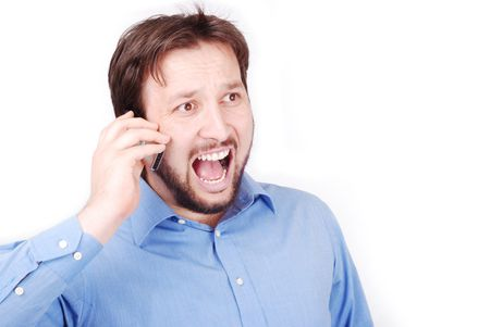 bawl: Young attractive man is bawling on his cell phone