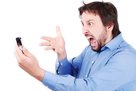 bawl: Young attractive man is yelling on his cell phone