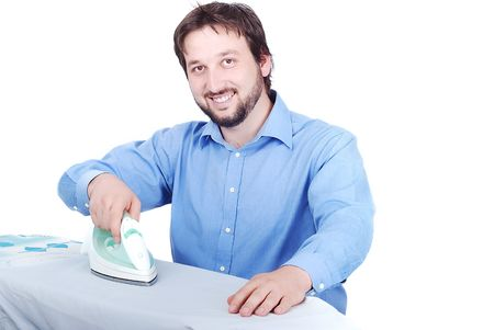Isolated man in blue shirt is ironing with a smile on his face Stock Photo - 5142135
