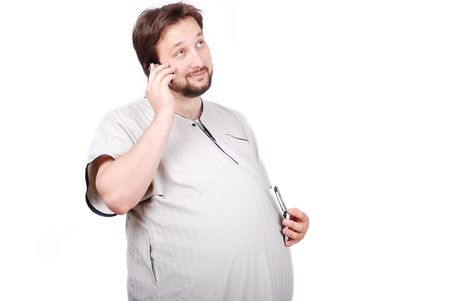 Young male with big stomach with enjoying expression on his face speaking on phone photo