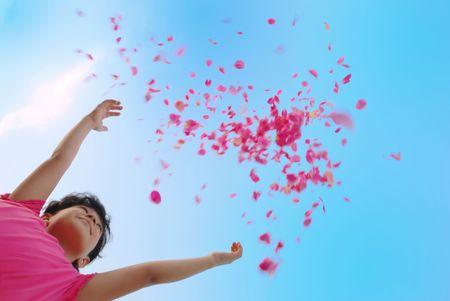 Girl droping petal of roses in air photo