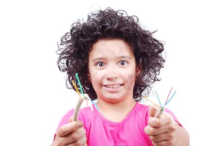 A cute girl is taking an electrical wire in hands photo