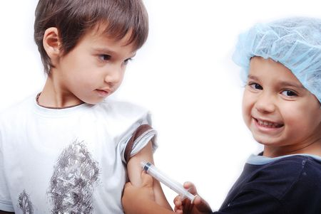 Two cute boys are playing as a doctors Stock Photo - 5171089