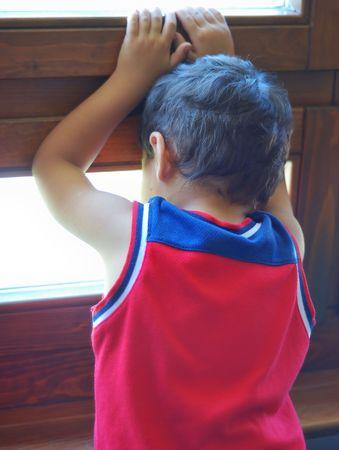 ing: Sad boy on the window