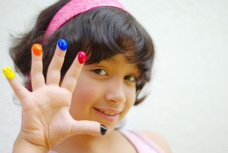 georgeous: Girl with color on her fingers and face looking