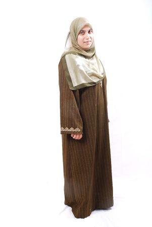 islamic prayer: A muslim traditional arabic woman in islamic dress Stock Photo
