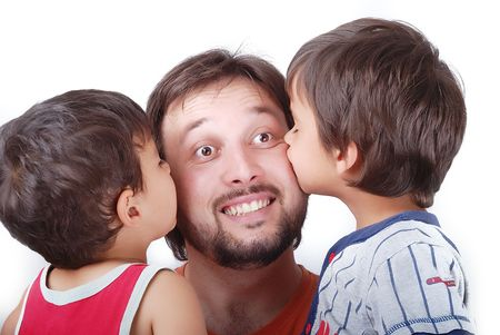 Lovely father is been kissed by his two sons photo
