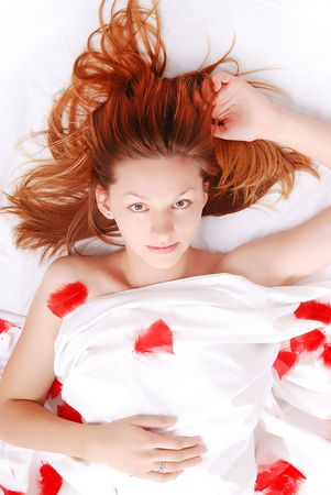 Beautiful girl laying on bed with white sheets Stock Photo - 5204672