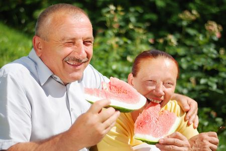 Happy elderly couple with water melon outdoor Stock Photo - 5204671