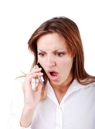 Young brunette with angry expression on face speakin on cell phone Stock Photo - 5213134