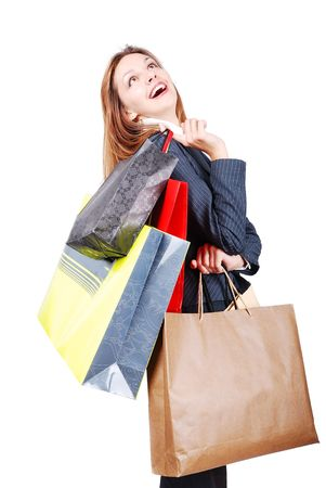 Attractive brunette smilling after shopping with bags photo