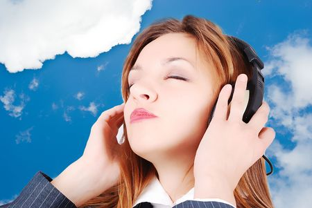 Sexy girl is listening to music with her head up photo