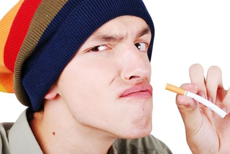 Funny face young man with cigarete in hand photo