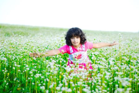 medow: Adorable girl on green grass in nature