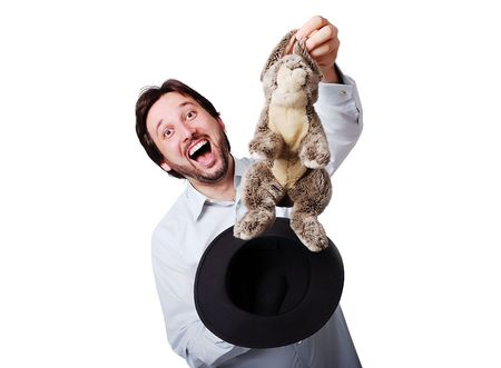 Funny man with big laugh with rabbit from the hat photo