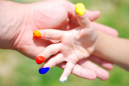 Color on hands. kid and father photo