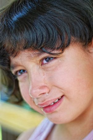 whine: Cute girl with true emotional tears Stock Photo