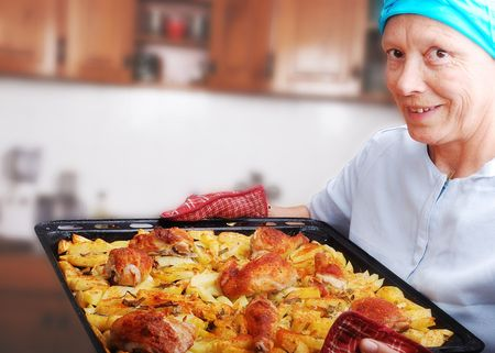 Women with prepared chicken and potato Stock Photo - 5256682