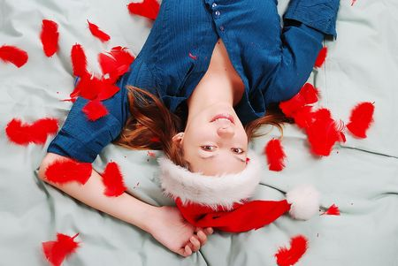 inocent: Adorable girl with santa hat laying on bed Stock Photo