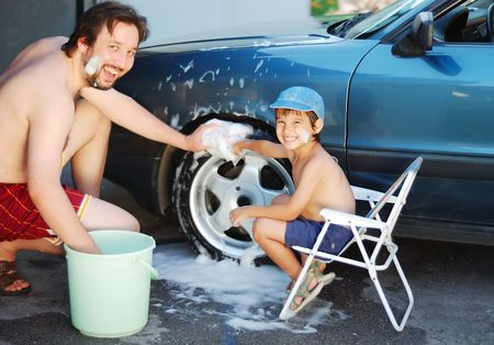 Child washing car and toy car photo