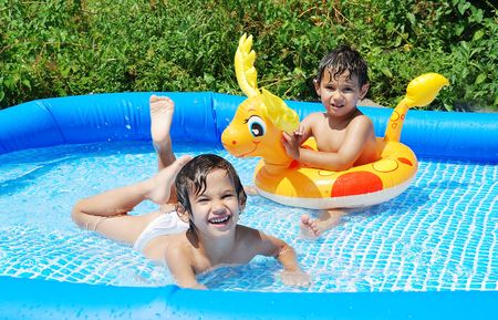 pool game: Children activities on swiming pool in summer Stock Photo