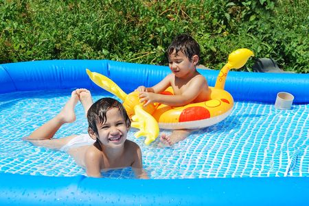Children activities on swiming pool in summer photo