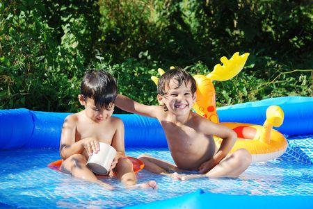 Children activities on swiming pool in summer photo