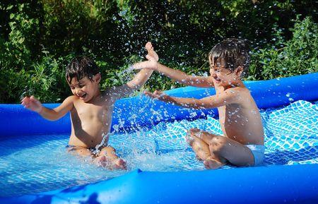 pool game: Children activities on swiming pool in summer Stock Photo