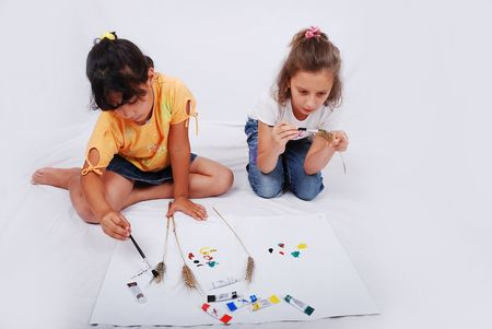 Beautiful scene of two girls and playing with colors on ground Stock Photo - 5288962