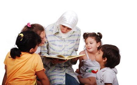 obedience: A young muslim woman in traditional clothes in education process