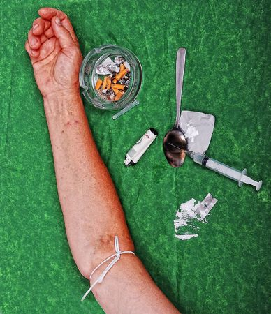 junkie: Drugs addict activities and some tools on table Stock Photo