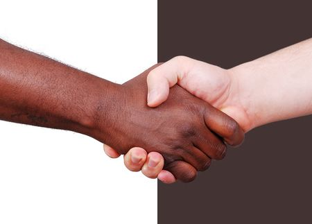african american handshake: Two hands shaking, black and white on background Stock Photo