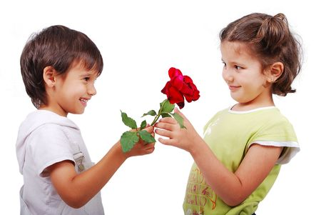 Very cute scene of two little children with rose Stock Photo - 5288978