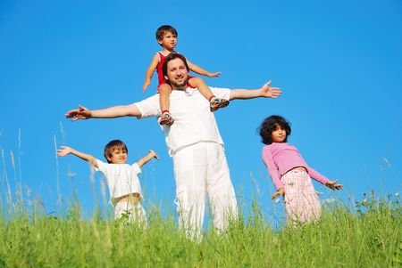 Happy family with four members on beautiful scene in nature Stock Photo - 5304824