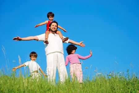 Happy family with four members on beautiful scene in nature Stock Photo - 5304817