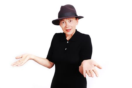 Middle aged woman wearing black dress and hat photo